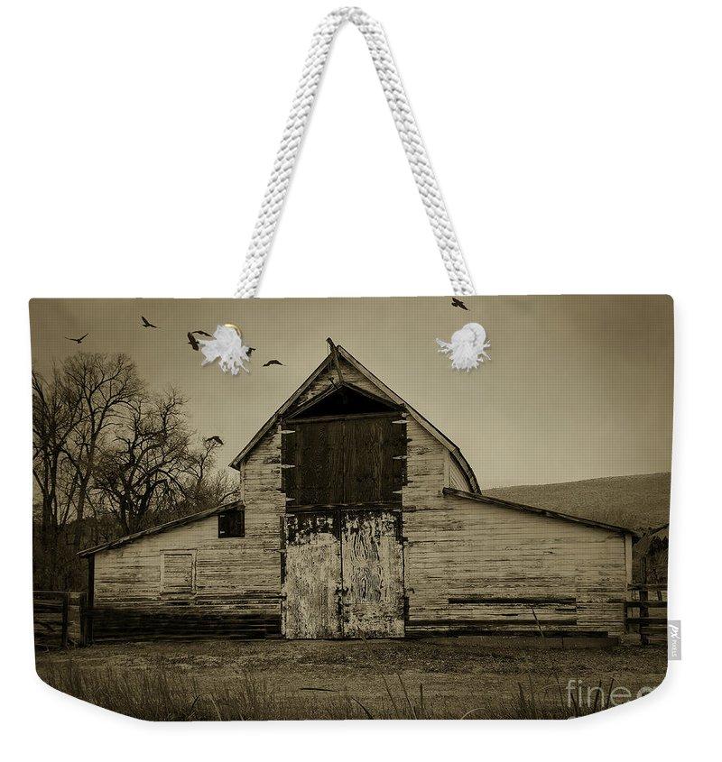 Barn Weekender Tote Bag featuring the photograph Smokey Prairie Barn by Janice Pariza