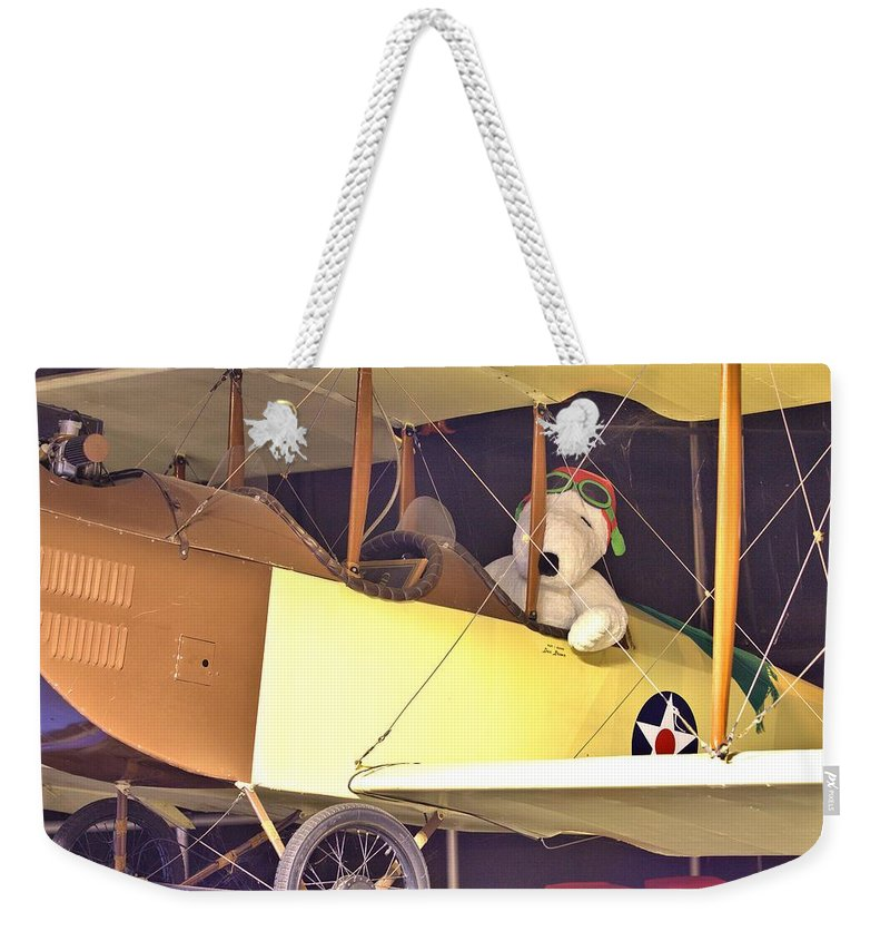 9812 Weekender Tote Bag featuring the photograph Snoopy In His Biplane by Gordon Elwell