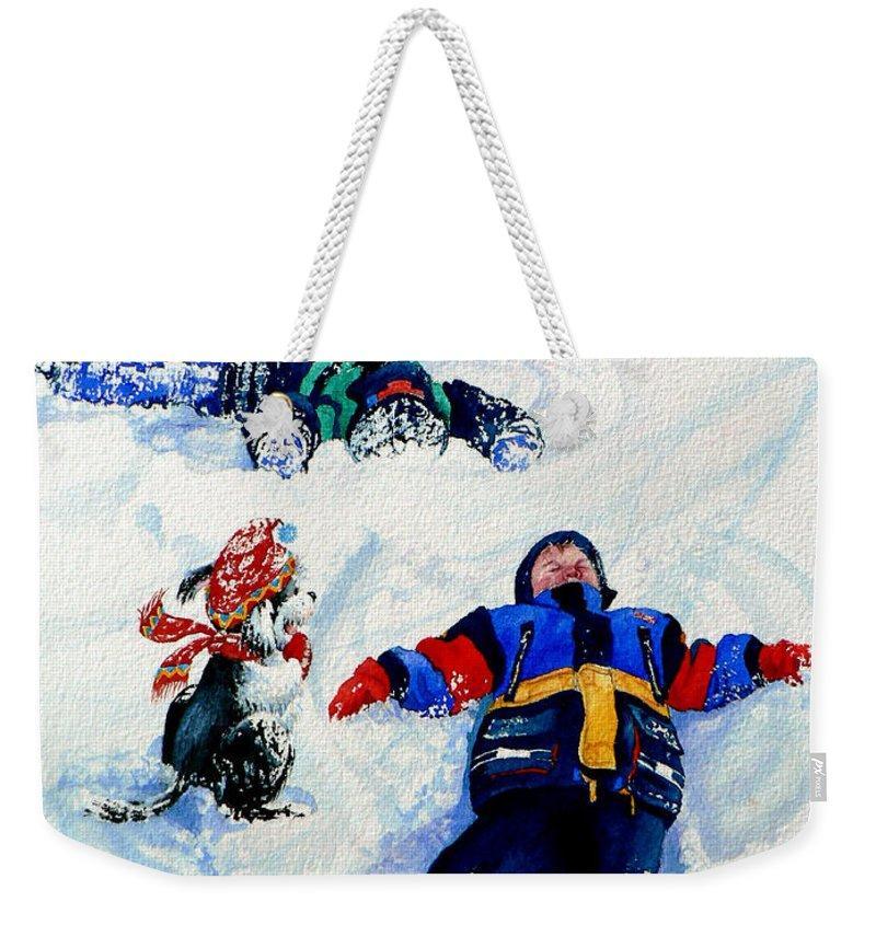 Kids In Snow Weekender Tote Bag featuring the painting Snow Angels by Hanne Lore Koehler