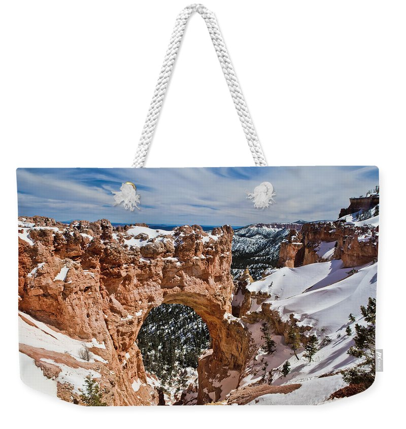 Beige; Big Sky; Bird; Black; Brown; Pine Weekender Tote Bag featuring the photograph Snow Capped Arch At Bryce by Evie Carrier