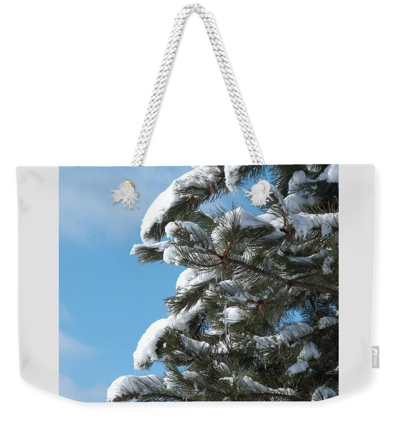 Snow Weekender Tote Bag featuring the photograph Snow-clad Pine by Ann Horn