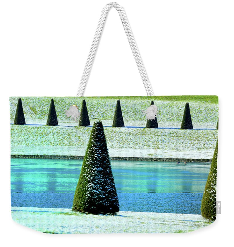 Tranquility Weekender Tote Bag featuring the photograph Snow Covered Garden by Martial Colomb