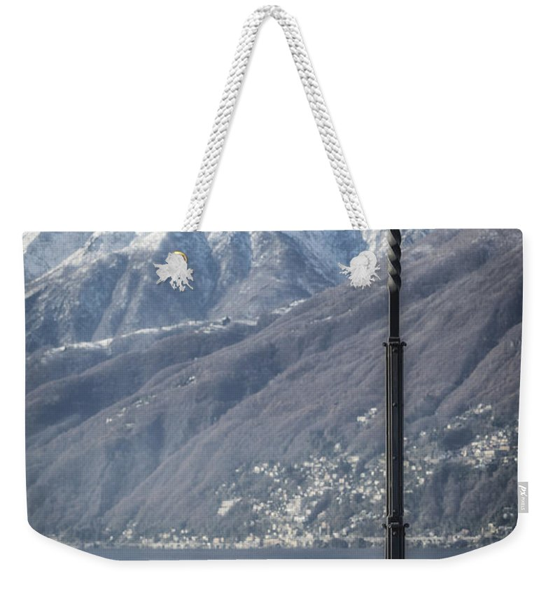 Girl Weekender Tote Bag featuring the photograph Snow Covered Mountains by Joana Kruse