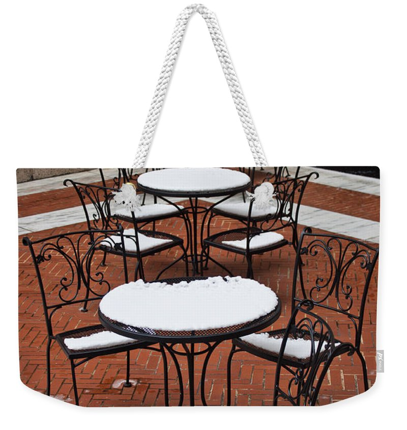 Boston Weekender Tote Bag featuring the photograph Snow Covered Patio Chairs And Tables by Thomas Marchessault