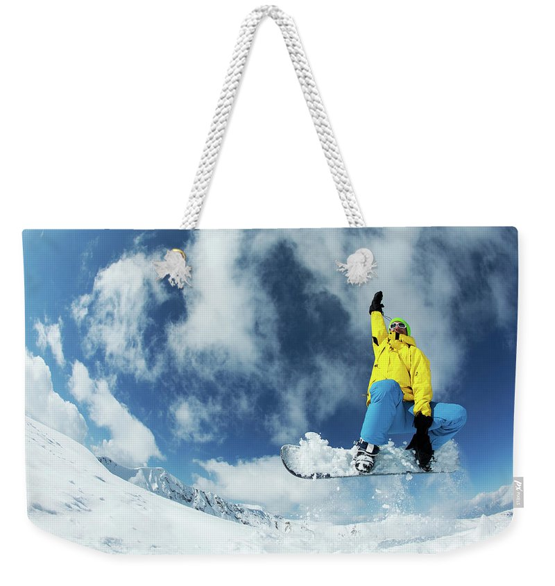 Young Men Weekender Tote Bag featuring the photograph Snowboarding by Yulkapopkova