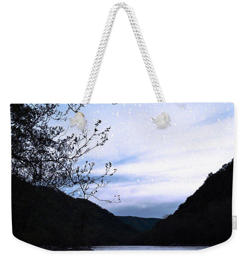 Lisa Lambert Weekender Tote Bag featuring the photograph Snowflakes On The River by Lj Lambert