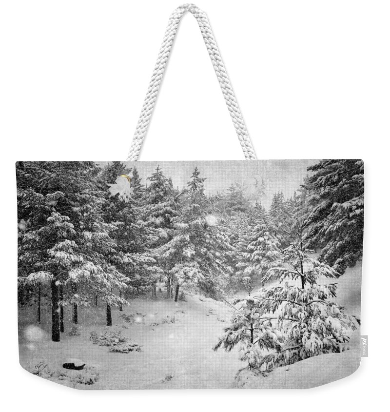 Black And White Weekender Tote Bag featuring the photograph Snowing At The Forest by Guido Montanes Castillo