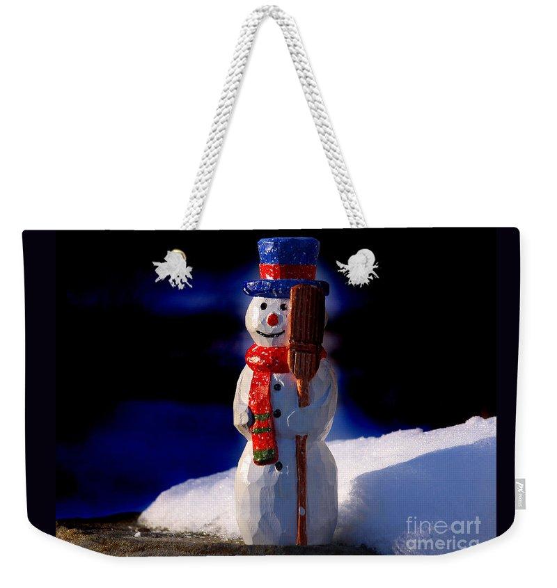 Snowman Weekender Tote Bag featuring the sculpture Snowman By George Wood by Karen Adams