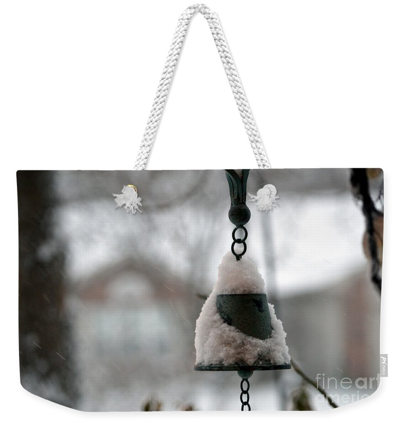 Winter Weekender Tote Bag featuring the photograph Snowy Bell by Alys Caviness-Gober
