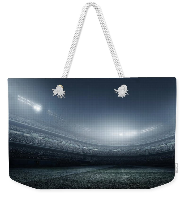 Soccer Uniform Weekender Tote Bag featuring the photograph Soccer Player With Ball In Stadium by Dmytro Aksonov