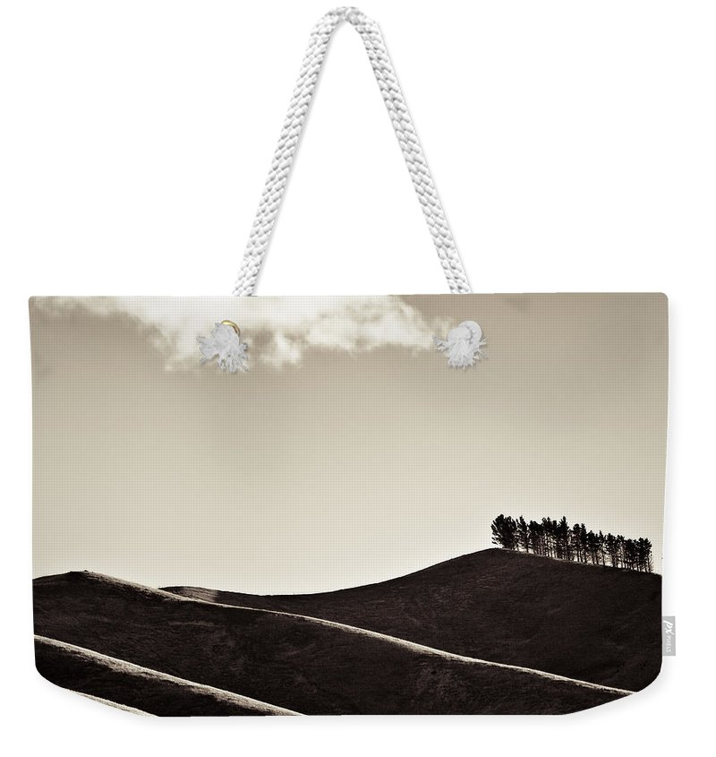 New Zealand Weekender Tote Bag featuring the photograph Solitary Cloud by Dave Bowman