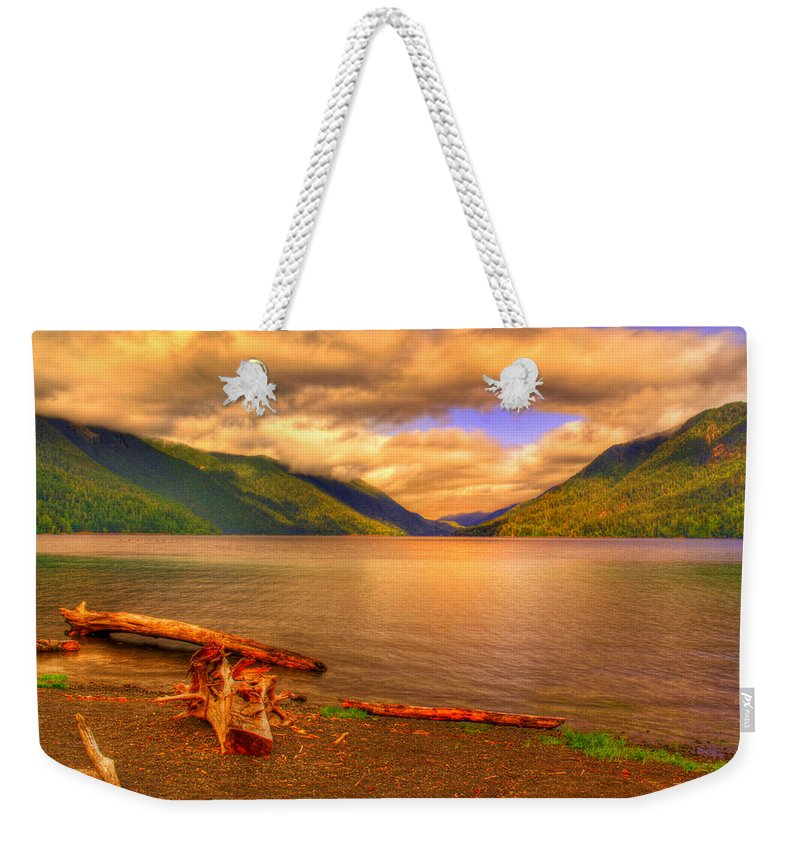 Lake Weekender Tote Bag featuring the photograph Solitude On Crescent Lake by John Absher