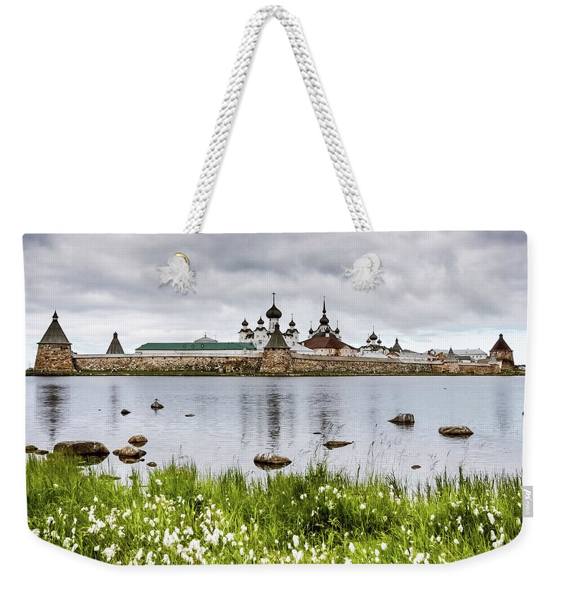 Grass Weekender Tote Bag featuring the photograph Solovetsky Monastery At Holy Lake by Mordolff