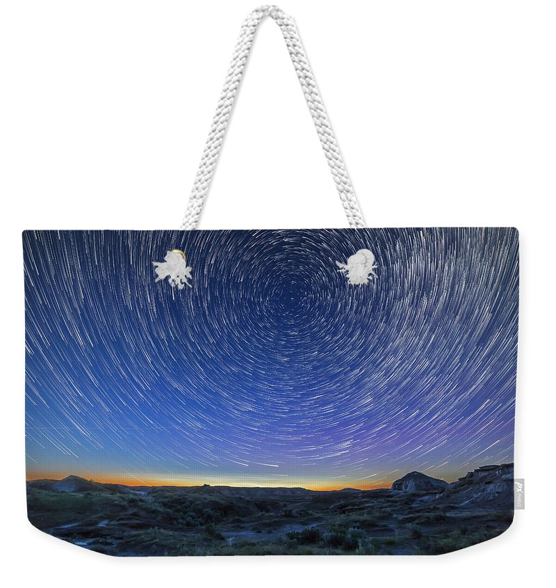 Advanced Stacker Actions Weekender Tote Bag featuring the photograph Solstice Star Trails At Dinosaur Park by Alan Dyer