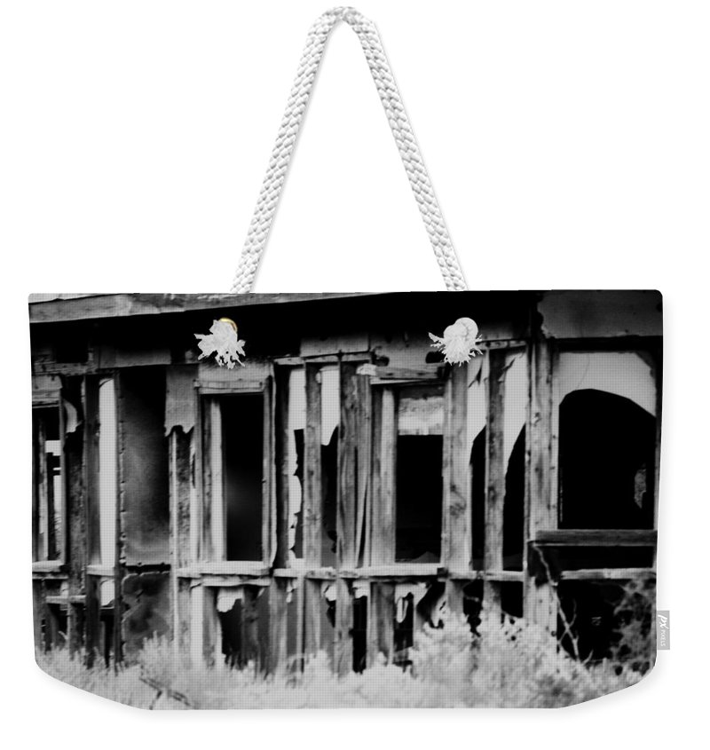 Black Weekender Tote Bag featuring the photograph Something Begins by Jessica Shelton