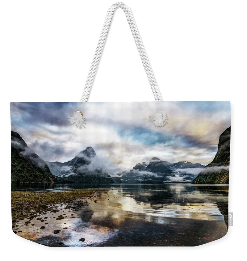 Scenics Weekender Tote Bag featuring the photograph Sound Asleep | Fiordland, New Zealand by Copyright Lorenzo Montezemolo