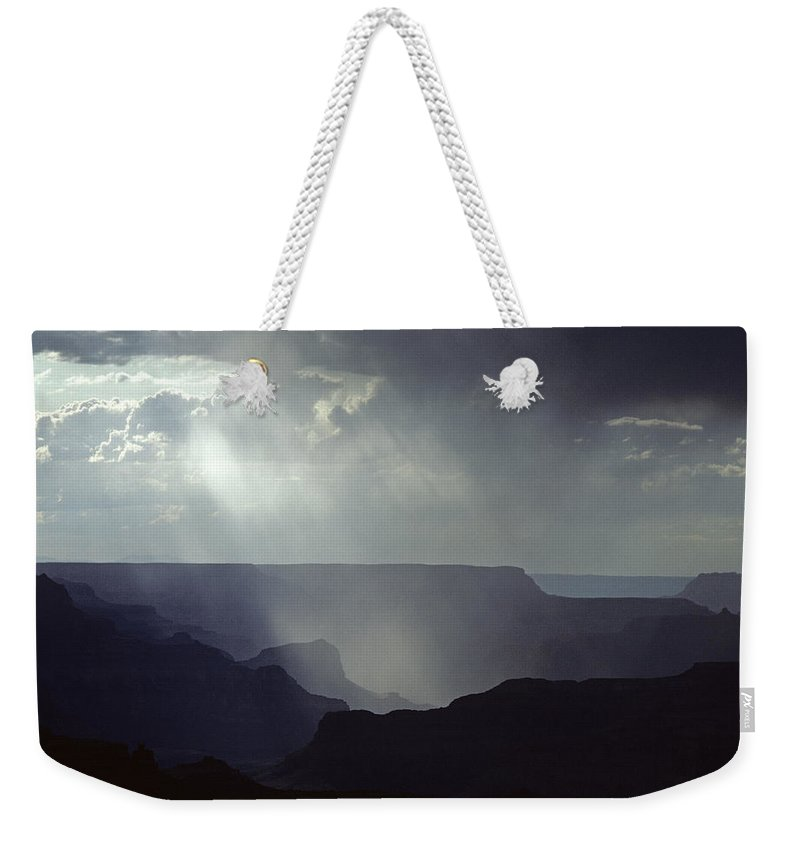 Grand Canyon National Park Weekender Tote Bag featuring the photograph South Rim Grand Canyon Storm Clouds And Light On Rock Formations by Jim Corwin