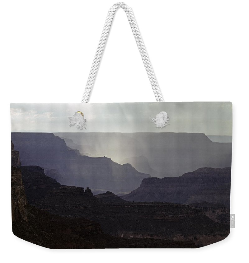 Grand Canyon National Park Weekender Tote Bag featuring the photograph South Rim Grand Canyon Storm Clouds And Sunray Light On Rock For by Jim Corwin
