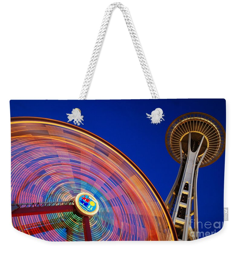 Space Needle Weekender Tote Bag featuring the photograph Space Needle And Wheel by Inge Johnsson