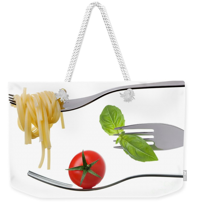 Italian Food Weekender Tote Bag featuring the photograph Spaghetti Basil And Tomato On Forks Isolated by Lee Avison