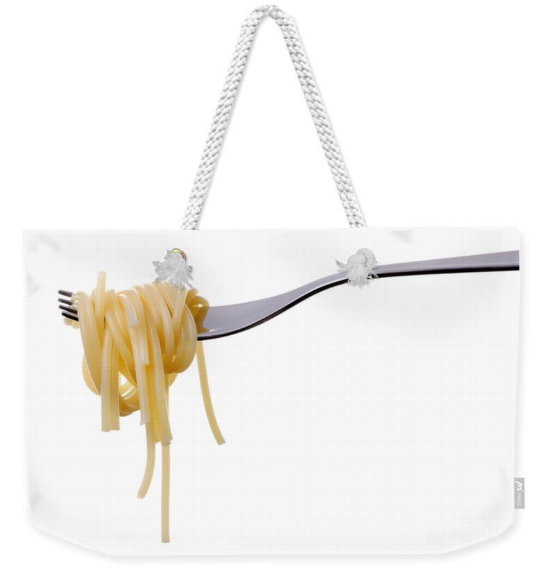 Pasta Weekender Tote Bag featuring the photograph Spaghetti On A Fork by Lee Avison