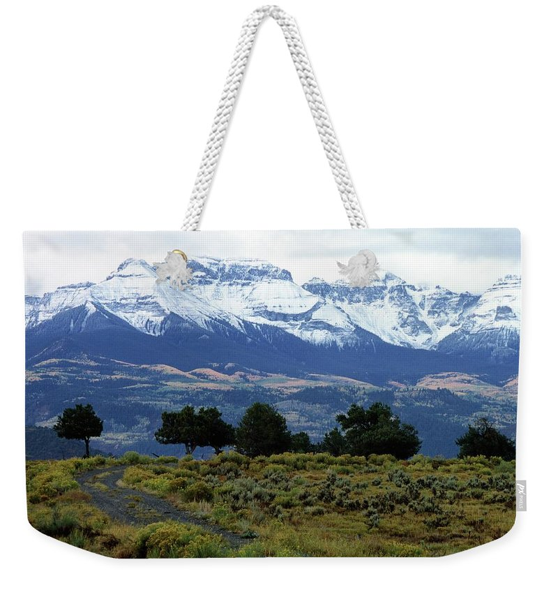 Colorado Weekender Tote Bag featuring the photograph Speaking In Silence by Eric Glaser