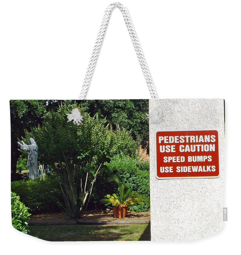Photograph Weekender Tote Bag featuring the photograph Speed Bumps Use Sidewalks by Marian Bell