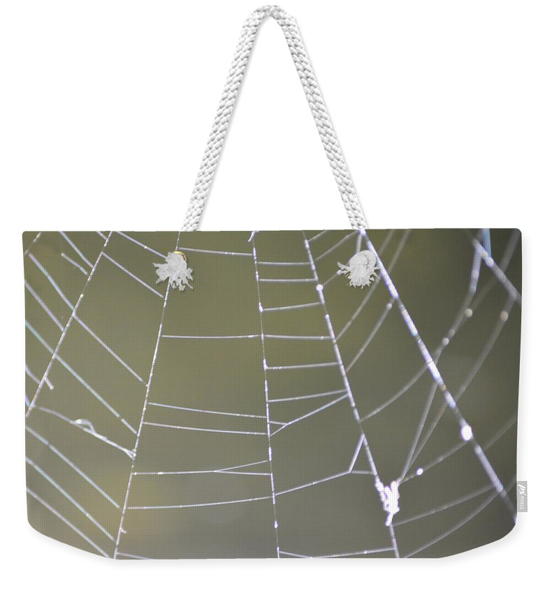 Abstract Weekender Tote Bag featuring the photograph Spiderweb by Brent Dolliver