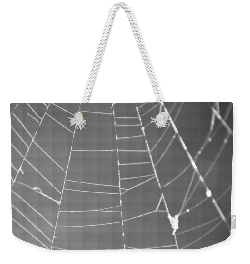 Abstract Weekender Tote Bag featuring the photograph Spiderweb Bw by Brent Dolliver