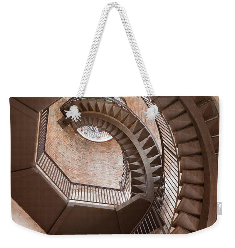 Tranquility Weekender Tote Bag featuring the photograph Spiral Staircase In Lamberti Tower by Buena Vista Images