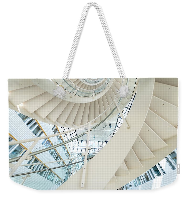 Steps Weekender Tote Bag featuring the photograph Spiral Staircase Inside Office Complex by Blurra
