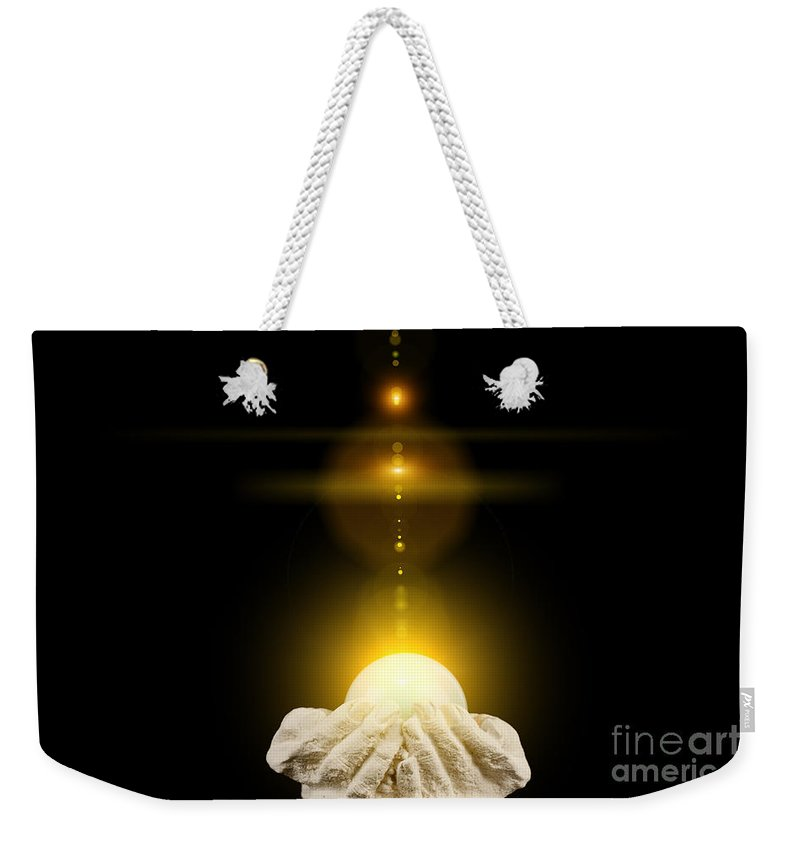 God Weekender Tote Bag featuring the photograph Spiritual Healing Light In Cupped Hands On Black by Simon Bratt Photography LRPS