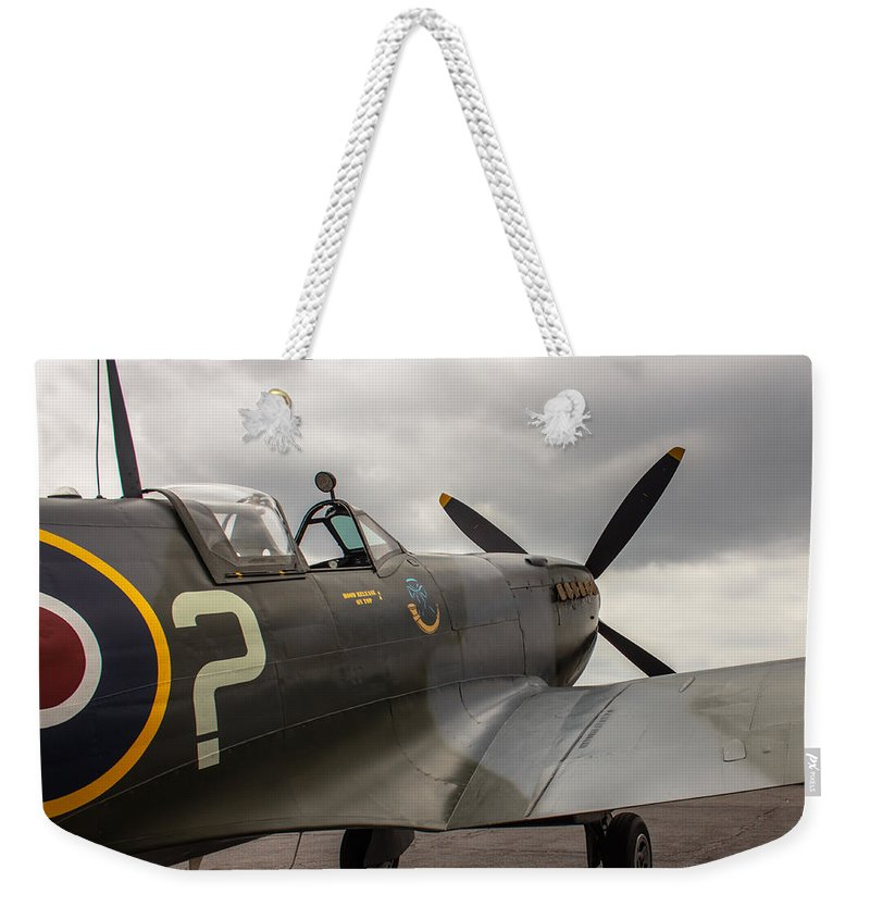 World War 2 Weekender Tote Bag featuring the photograph Spitfire On Display by Jorge Perez - BlueBeardImagery