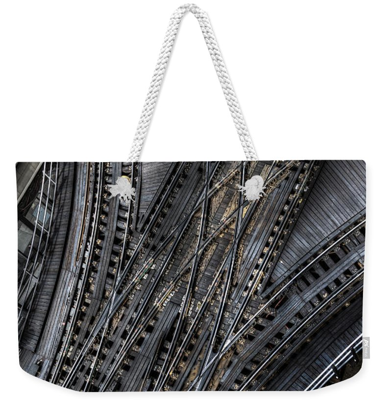 Elevated Weekender Tote Bag featuring the photograph Split Decision by Margie Hurwich