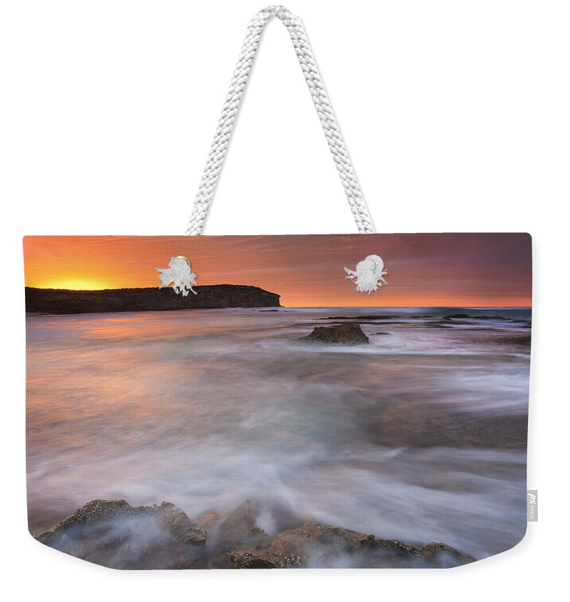 Sunrise Weekender Tote Bag featuring the photograph Splitting The Tides by Mike Dawson