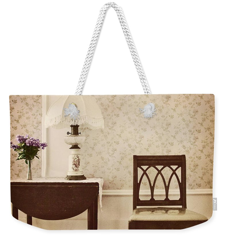 Chair; Table; Inside; Seat; Indoors; Empty; Floral Design; Alone; Brown; One; Interior; Still Life; House; Home; Wall Paper; Pretty; Wood; Floor; Runner; Side; Table; Lamp; Shade; Vase; Flowers; Lilacs Weekender Tote Bag featuring the photograph Sprig Of Lilacs by Margie Hurwich