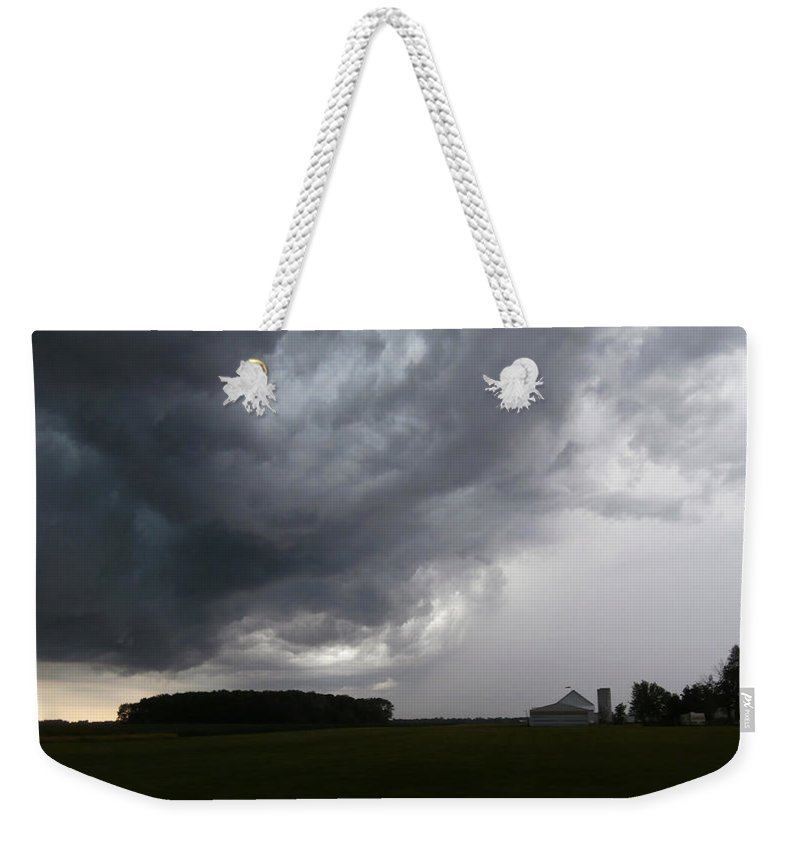 Storm Weekender Tote Bag featuring the photograph Spring Storm by Dan McCafferty