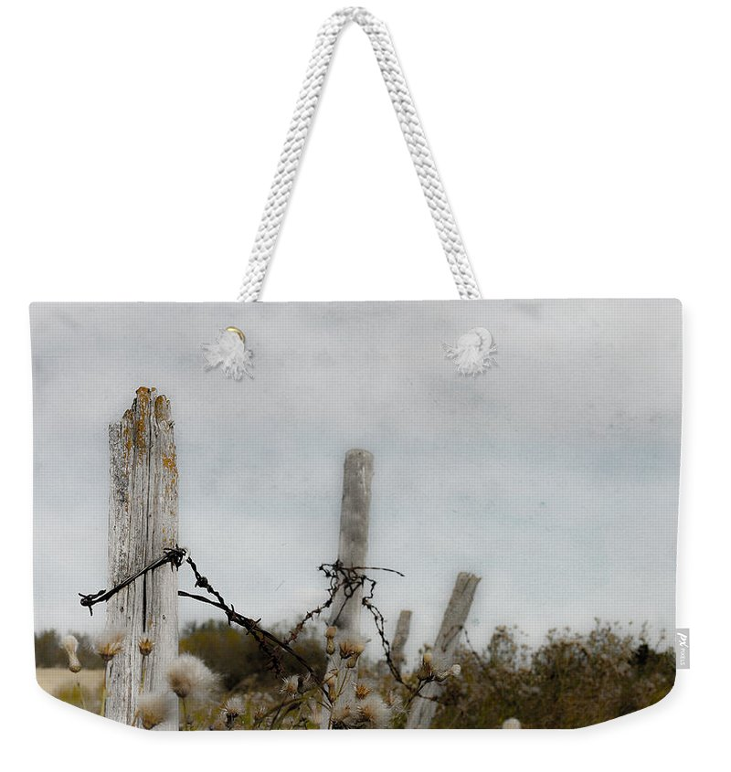 Flowers Weekender Tote Bag featuring the photograph Spring Sweats by The Artist Project