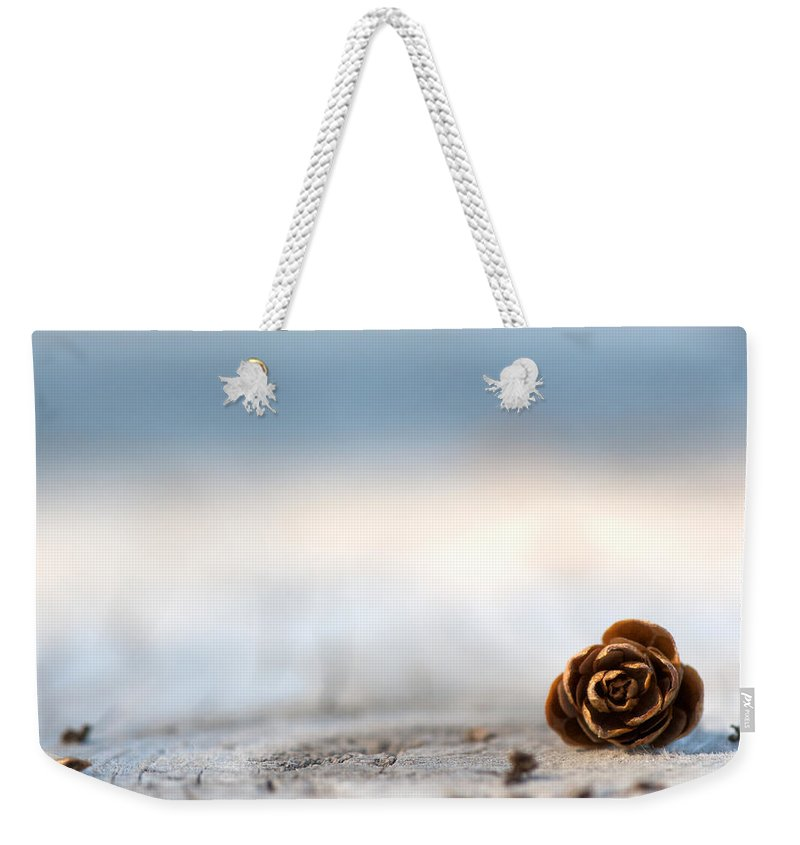 Pine Cone Weekender Tote Bag featuring the photograph Squirrel Leftovers by Lisa Knechtel