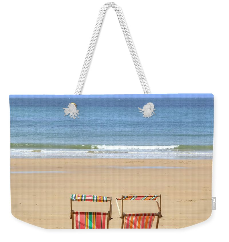 St Brelade Weekender Tote Bag featuring the photograph St Brelade's Bay - Jersey by Joana Kruse