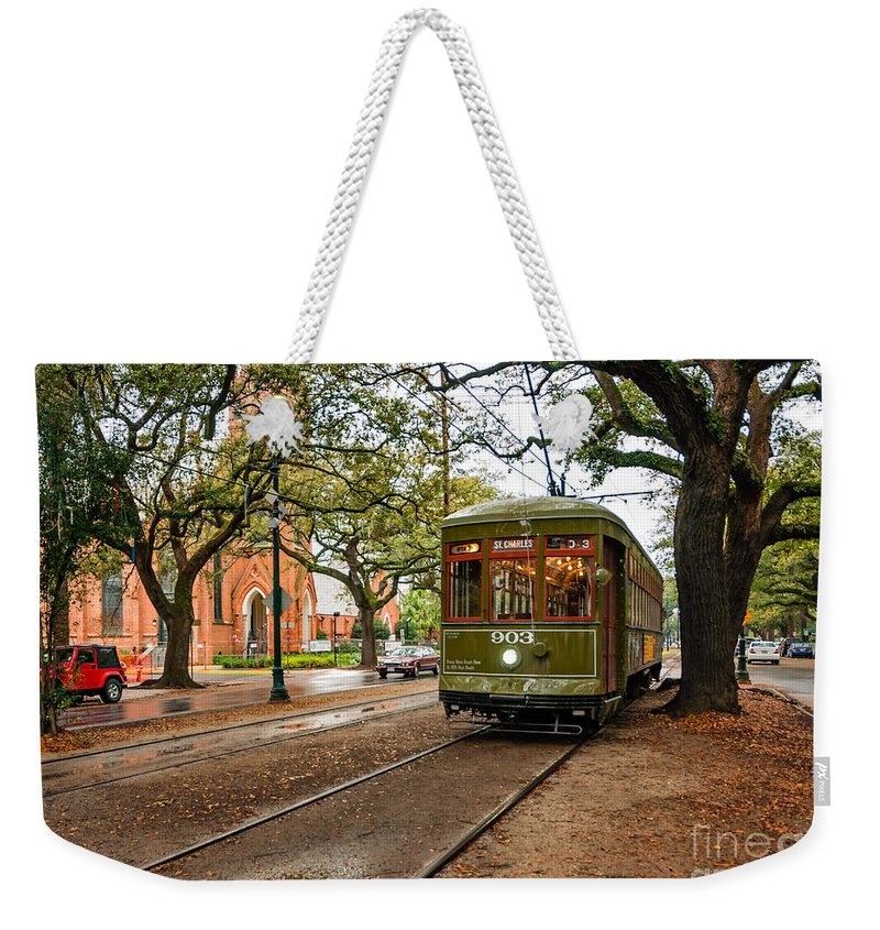 Garden District Weekender Tote Bag featuring the photograph St. Charles Ave. Streetcar In New Orleans by Kathleen K Parker