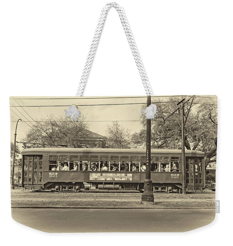 Nola Weekender Tote Bag featuring the photograph St. Charles Ave. Streetcar Sepia by Steve Harrington