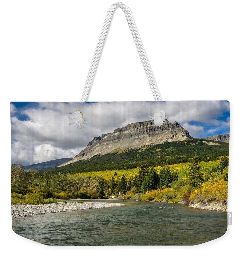 Glacier National Park Weekender Tote Bag featuring the photograph St. Mary River And East Flattop Mountain by Greg Nyquist