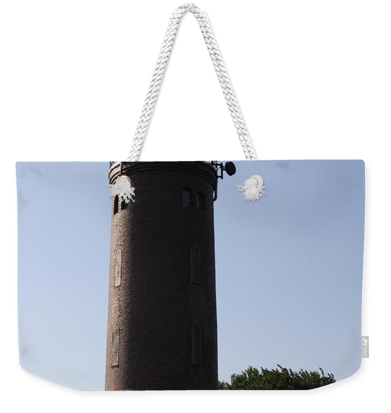 Lighthouse Weekender Tote Bag featuring the photograph St. Peter-ording Lighthouse - North Sea - Germany by Christiane Schulze Art And Photography