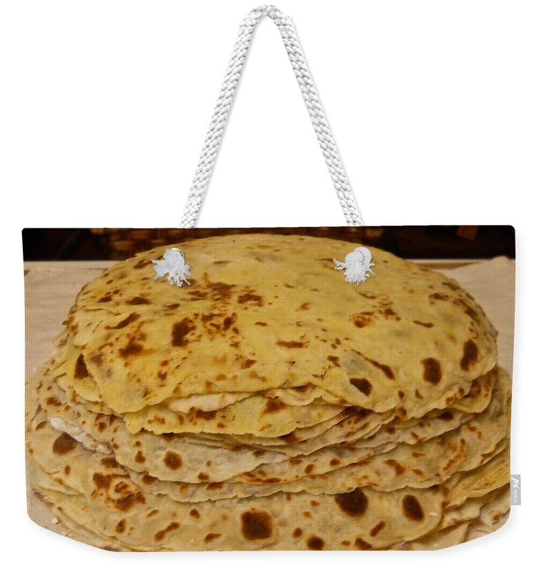 Lefse Weekender Tote Bag featuring the photograph Stack Of Lefse Rounds by Kent Lorentzen