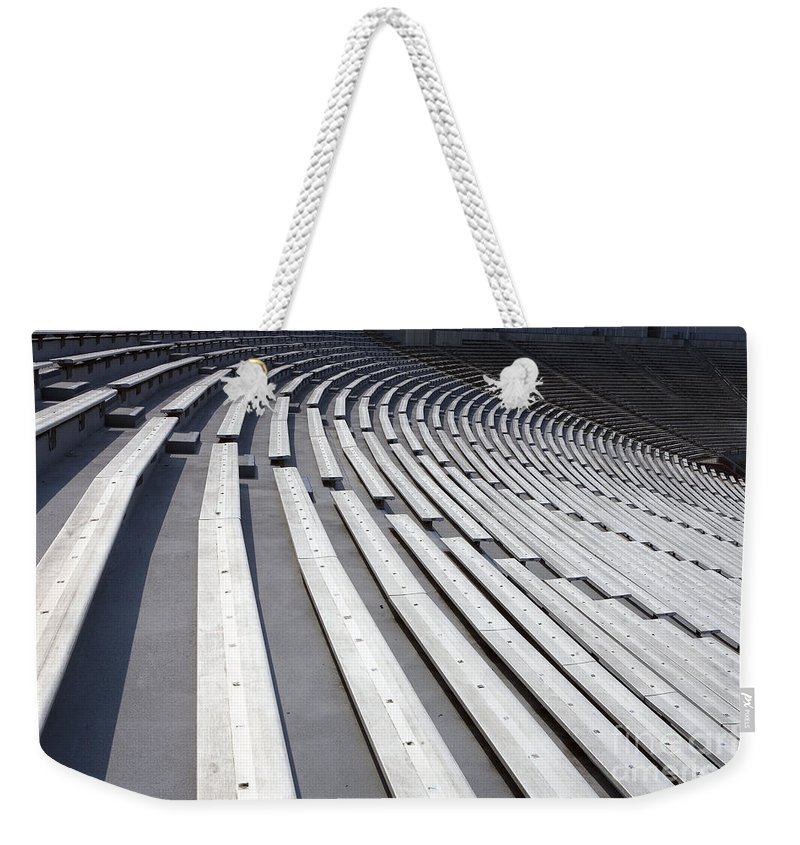 Scott Stadium Weekender Tote Bag featuring the photograph Stadium Bleachers by Jason O Watson