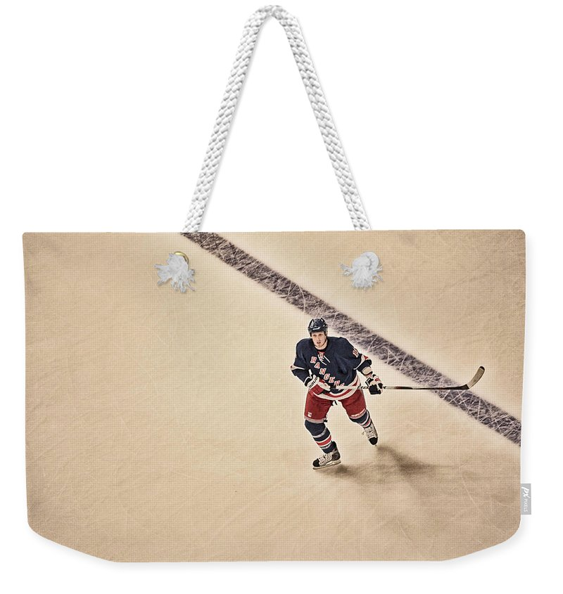 Hockey Weekender Tote Bag featuring the photograph Stallzy by Karol Livote