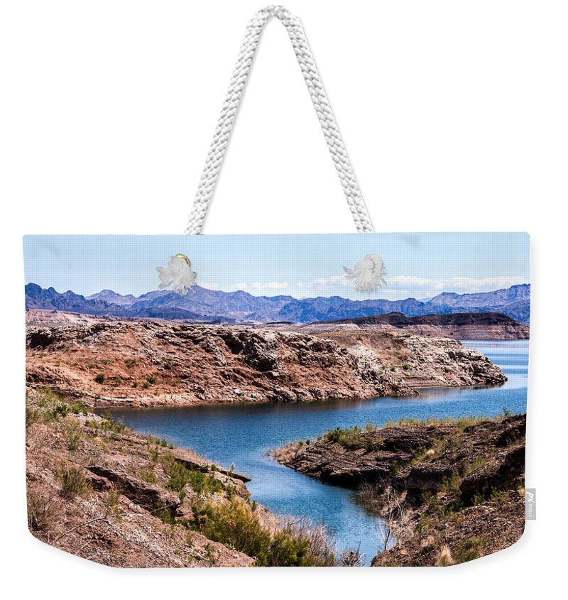 Lake Mead National Recreation Area Weekender Tote Bag featuring the photograph Standing In A Ravine At Lake Mead by Onyonet Photo Studios
