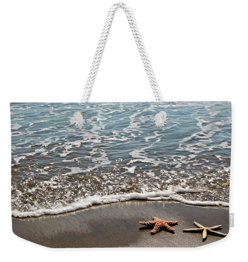 Star Fish Weekender Tote Bag featuring the photograph Starfish Catching The Waves by Athena Mckinzie