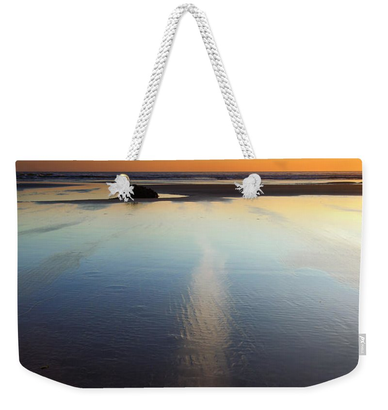 Starfish Weekender Tote Bag featuring the photograph Starfish Sunset by Mike Dawson